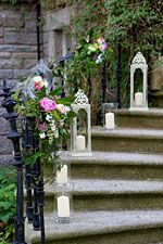Wedding stairs flower arrangement and candle decoration