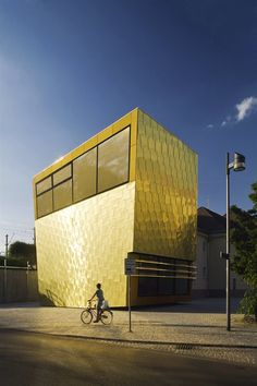 """""""When the town of Luckenwalde [Germany] wanted to convert their old, dusty train station into a public library, they turned to ff-Architeckten. When the architects wanted a way to signify that this building had been transformed into something new, they turned to creating a giant, guilded parallelogram added to the existing structure...""""  Click through for more info and pictures."""