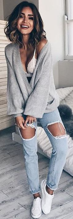the best way to mix lace bra with V-neck sweater and pair it with cool rips