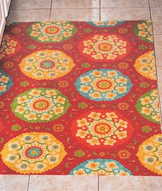 DIY rug - Vinyl scrap covered in fabric with polyurethane so you can wipe it clean!