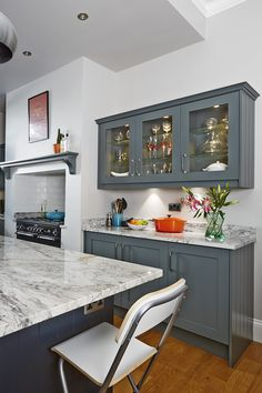 Kitchen cabinets painted in Farrow & Ball Downpipe, island painted in Railings   via AO at Home Blog