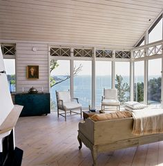 would love to build a sofa/bench similar to this for porch             Swedish coastal home by Jacob Cronstedt - that view!