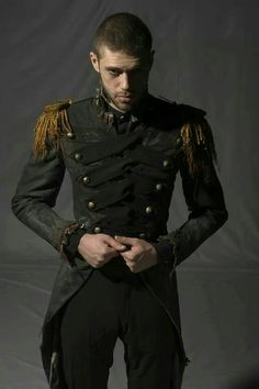 Uniform, steampunk style man in army jacket. Visit http://www.designyourownperfume.co.uk  Benedick