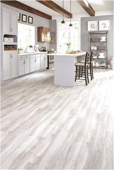 Gray tones mixed with light creams and tans suggest a floor worn over time, evoking a classic yet contemporary style. Check out this featured style! #CeramicFloorPatterns #FloorPatterns #Flooring click for more info..