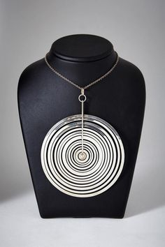 by Tapio Wirkkala, Finland. Rare large version of this 1973 pendant. Sterling silver. D: 11 cm/ 4 1/4''