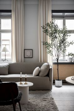 Home tour - a cosy Stockholm apartment in soft shades of grey - {Living room / Wohnzimmer} - Design Decor Scandinavian, Scandinavian Apartment, Scandinavian Lighting, Living Room Designs, Living Room Decor, Living Spaces, Curtain For Living Room, Modern Living Room Curtains, Fresh Living Room