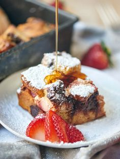 Strawberry Nutella Cream Cheese French Toast Casserole. Thick slices of brioche are smothered in nutella and layered with strawberries and cream cheese!
