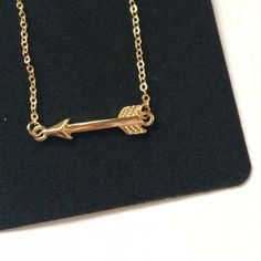 """Arrow Pendant necklace This necklace measures 16"""" w by 2"""" l and the arrow measures 1"""" by 1/4. Poshmark transactions only. Smoke free, cat friendly home. Photos courtesy of Farah Jewelry. Farah Jewelry Jewelry Necklaces"""