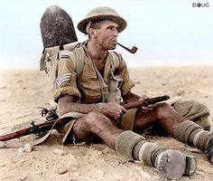 New Zealand Army Sergeant Ian Thomas sits down and smokes a pipe with his Lee Enfield during the North African Campaign in Egypt 1942. (Colorized by Doug Banks)creds  @world.war.2_ Tag a friend that would love my page please! ___________________________________  #ww2 #wwii #worldwar2 #war #wartime #warhistory #military #militaryhistory #history #allies #axis #army #armylife #armystrong #soldiers #gear #guns #weapons #germans #germany #follow #european #gloryofprussia #quotes…
