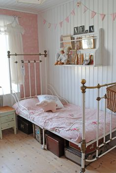 adorable girls room with iron bed in shabby chic pink and white