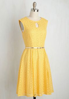 Sure, you could secretly stroll up to the party in this bright yellow dress, but your ensemble deserves adulation upon arrival! After all, with the keyhole neckline, golden belt, and circular lace overlay this eye-catching A-line offers, there's no way that your attendance will go without applause!