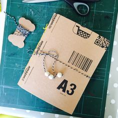 making a sketchbook from the Amazon cardboard envelope!