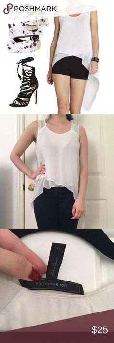 Mellie BCBG asymmetrical white tank Feel the breeze in this flowy draped top. It offers the perfect juxtaposition with short shorts or a tight pair of leggings. Says XS, but fits larger.   Round neck. Sleeveless. Tiered asymmetrical hem. Longer at back. Keyhole at back neck. 100% Silk. Dry Clean. In EUC! BCBGMaxAzria Tops Tank Tops