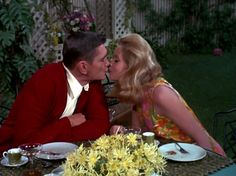 Elizabeth Montgomery and Dick York from Bewitched. Love her dress!