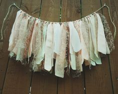 A sweet shabby scrap garland backdrop/wall hanging to brighten up any occasion!  Blush, pink, mocha, tan, beige and cream tones make up this