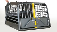 MIM Variocage Double | 4x4NorthAmerica  MIM Safe Variocage Double     The MIM Safe Variocage Double features a movable center divider that is easily adjustable if one of the dogs needs more space. If you have a large dog or if you want to give a single dog more space, this center divider is easily removed. The flexibility of the MIM Safe Variocage can easily be tailored to the dog and the vehicle by the owner.
