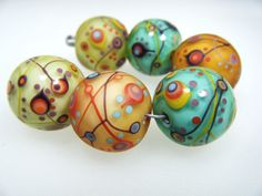 Moogin -tapestry pattern round lampwork bead set -18mm- SRA. £42.00, via Etsy.