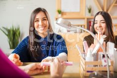 Cute women getting a manicure royalty-free stock photo