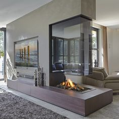 Double Sided Fireplace I Two Sided Fireplace I Tunnel Fireplace I See Through Fireplace Hanging Fireplace, Double Sided Fireplace, Home Fireplace, Living Room With Fireplace, Fireplace Design, Fireplace Glass, Linear Fireplace, Fireplace Modern, Open Plan Kitchen Living Room