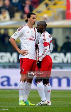 Zlatan Ibrahimovic and Clarence Seedorf (R) of AC Milan wait to start play during the Serie A match between Bologna FC and AC Milan at Stadio Renato Dall'Ara on December 11, 2011 in Bologna, Italy.