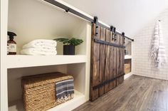 WEBSTA @ beginninginthemiddle - Custom built-ins and mini barn doors were the perfect solution to the wasted knee wall space at ☺️ Attic Bedroom Storage, Attic Bedrooms, Attic Bathroom, Bathroom Storage, Bathroom Built Ins, Upstairs Bedroom, Eaves Storage, Loft Storage, Built In Storage