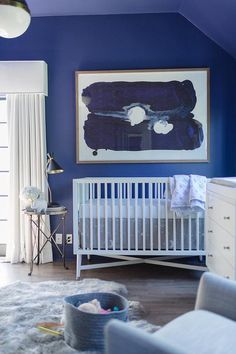 White And Blue Boy S Nursery Features Walls Painted Bold Lined With A Dwell Studio Mid