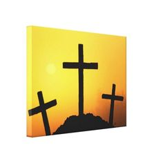Old wooden cross on Calvary hill at sunset. Wrapped canvas print.