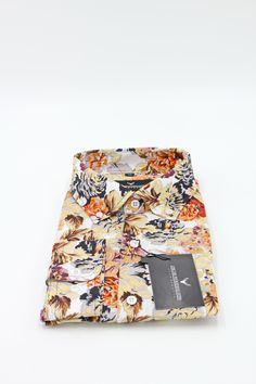Men's Shirt. Feel the summer with floral prints! Our Kirsinger button-down shirt is made from a soft feelin poplin fabric and comes in a slim fit.