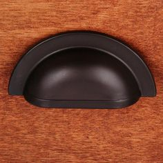 This oil rubbed bronze finish cabinet/drawer cup pull with smooth half circle design from RK International is perfect for use on cabinet doors and drawers capable of accepting a mounted pull.