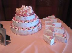 """Favor cake for my daughters christening... Each """"slice"""" is really a decorated gift box containing a rosary bead bracelet... Purchased from LMKgifts.com"""