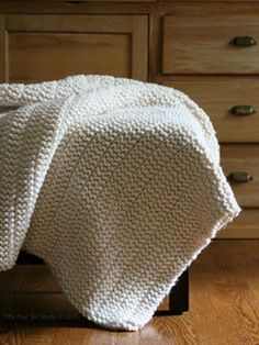 The Boulevard Blanket knitting pattern by Fifty Four Ten Studio.  This throw blanket is quick to knit with super bulky yarn.  Free pattern on Ravelry.