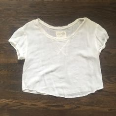Perfect condition Free People top This free people top has only been worn 2 or 3 times and is in perfect condition. It is very cute, white with a frayed design neckline Free People Tops Crop Tops
