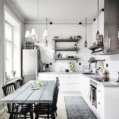 White kitchen of the lovely Gothenburg apartment that you can see on my blog…