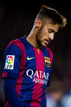 Neymar Santos Jr of FC Barcelona looks on during the La Liga match between FC Barcelona and RCD Espanyol at Camp Nou on December 7, 2014 in Barcelona, Catalonia.