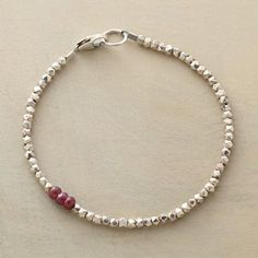 """DIVERSIONS BRACELET Item No. 64936$158.00 Asymmetrical and lovely, this sterling and ruby beaded bracelet catches the eye with its unique design.  In this sterling and ruby beaded bracelet, three rubies form a colorful diversion, interrupting sterling silver beads. Exclusive. Handmade in USA. Lobster clasp. 7-1/4""""L."""