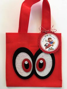 """These treat bags are a perfect addition to your Super Mario Odyssey themed party. It's the perfect way to say, """"Thank You,"""" for celebrating the birthday kid's big day! This listing is for a set of 12 reusable-durable mini tote Favor Bags and 12 personalized Thank You Tags. You just have"""