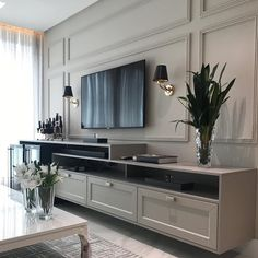 Living room with classic-style home TV, gray woodwork and elegant sconces Pre . Living room with Living Room Interior, Home Living Room, Living Room Decor, Tv On Wall Ideas Living Room, Sconces Living Room, Home Room Design, Home Interior Design, Luxury Interior, House Design