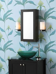 Black vanity & medicine cabinet, blue-green glass vessel sink, and botanical print wallpaper in French Blue & Sage Green create tranquil powder room. Blue Floral Wallpaper, Print Wallpaper, Wallpaper Maker, Bold Wallpaper, Eames, Cole And Son Wallpaper, Bathroom Colors, Design Bathroom, Bathroom Interior