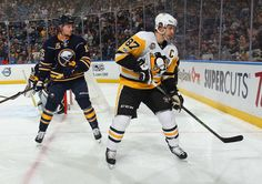 Sabres vs. Penguins - 03/21/2017 - Pittsburgh Penguins - Photos  Sidney Crosby #87 of the Pittsburgh Penguins and Jack Eichel #15 of the Buffalo Sabres follow the play