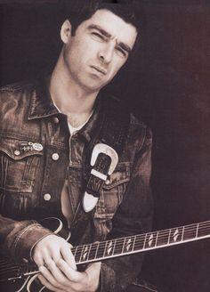"Cover Boy Noel Gallagher of Oasis modeling one of his El Dorado ""Original Model"" guitar straps"