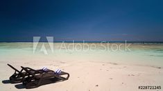 Stock Footage of Luxury beach chairs and towels on tropical island, white sandy beach on sunny day at private holiday/honeymoon resort, scattered clouds. Timelapse Explore similar videos at Adobe Stock Beach Chairs, Stock Video, High Quality Images, Sunny Days, Stock Footage, Sunnies, Towels, Adobe, Tropical