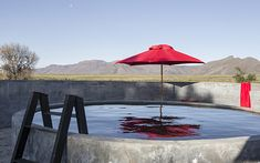 Kliphuis is situated on a remote nature reserve in the heart of the great Karoo under the Sneeuberg Mountain Range just an hour from Graaff Reinet. Coffee Candle, Road Trippers, 2nd City, Beach Umbrella, Old Stone, Stone Flooring, Nature Reserve, Stargazing