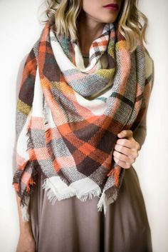 This orange and brown plaid blanket scarf is one to definitely keep you warm…