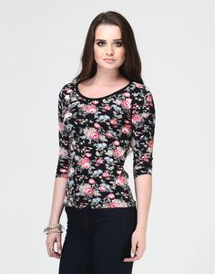 Sassy Back Floral Tee : Pack a punch in this rad cool jersey tee featuring the sweetest floral print and a cut out detailing at back. Three quarter sleeves.  Work It - Looks casually cool with your daily denims and a set of gold midi rings.