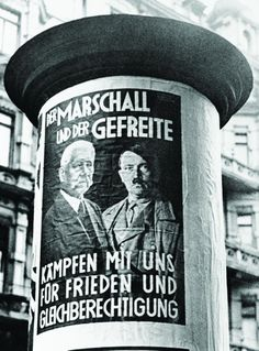 "In a photograph taken on September 1, 1933 and featured in Newsweek's November 24, 1933, edition, a German election poster lauds ""The Marshal and the Private,"" a reference to Hindenberg and Hitler's military ranks. Six years later to the day, Hitler would invade Poland in his first act of Blitzkrieg."