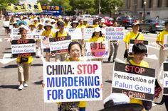 Falun Gong practitioners hold a march in Washington on July 14, calling for Jiang Zemin, the former dictator who instigated the persecution of Falun Gong in China, to be brought to justice. (Larry Dye/Epoch Times)