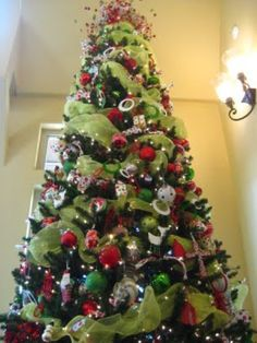 decorating christmas tree with deco mesh