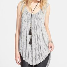Free People hummingbird moonshine tunic Amazing tunic tank by free people with a gray and black print and criss cross detail on the back. New with tags. Oversized fit, XS but could fit XS-M/L depending how you like the fit. Free People Tops Tunics