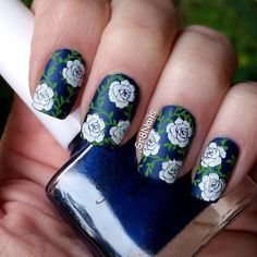 flower nail art with UberChic stamping plates Like the idea to stamp the leaves first and then the flowers over top, but I'd use different colors.