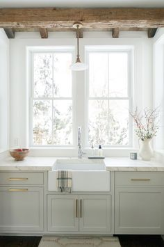 Today we have a round-up of inspiring non-white kitchens for those of you craving a different look. Sherwin Williams Repose Gray Cabinets - Gold Hardware - Quartz Counter Tops - Wood Beams in Kitchen - Rustic Kitchen - Farmhouse Sink - Farmhouse Kitchen White Farmhouse Kitchens, Farmhouse Sink Kitchen, New Kitchen, Kitchen Dining, Kitchen Rustic, Kitchen Ideas, Kitchen Hacks, Awesome Kitchen, Farmhouse Style